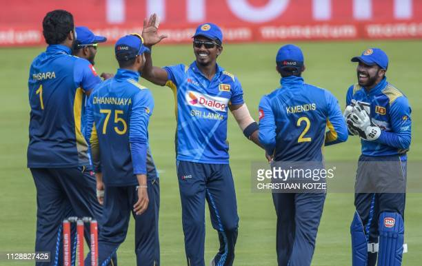 Sri Lanka's Thisara Perera celebrates with his teammates after getting the wicket of South Africa's Wicketkeeper Quinton de Kock during the second...