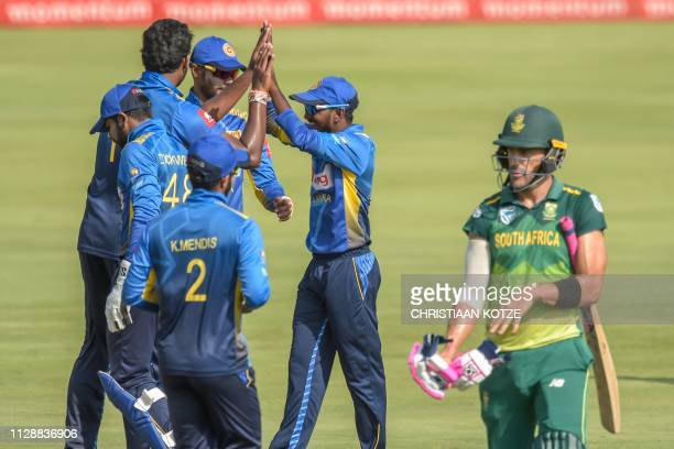 Sri Lanka's Thisara Perera celebrates with Sri Lanka's Niroshan Dickwella after getting the wicket of South Africa's Faf du Plessis during the second...