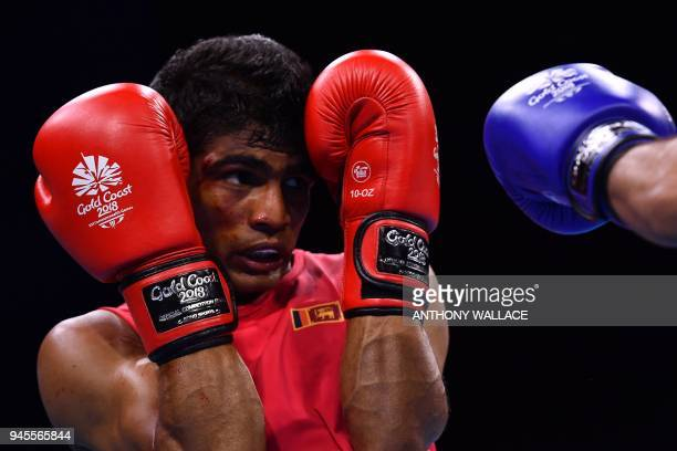 Sri Lanka's Thiwanka Ranasinghe guards against England's Galal Yafai during their men's 4649kg semifinal boxing match during the 2018 Gold Coast...
