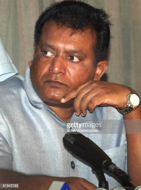 Sri Lanka's top Tamil Tiger guerrilla leader Velupillai Prabhakaran listens to a speaker during a press conference 10 April 2002 his first press...