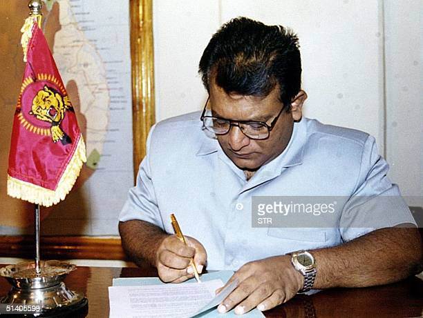 Sri Lanka's top Tamil Tiger leader Velupillai Prabhakaran signs a historic ceasefire agreement in Kilinochchi 20 February 2002 to clear the way for...
