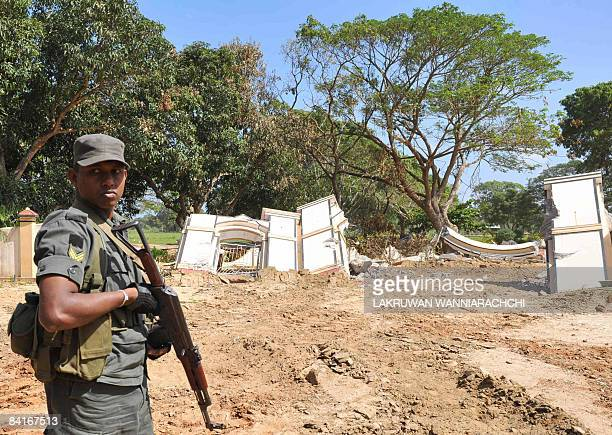 Sri Lanka's troops stand guard outside the war cemetery at the Tamil Tiger political capital town of Kilinochchi some 330 kilometers north of Colombo...