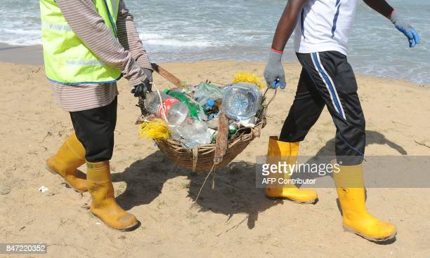 Sri Lankas urban development staff and volunteers take part in a beach cleanup effort on September 15 2017 at Mount Lavinia on the outskirts of the...