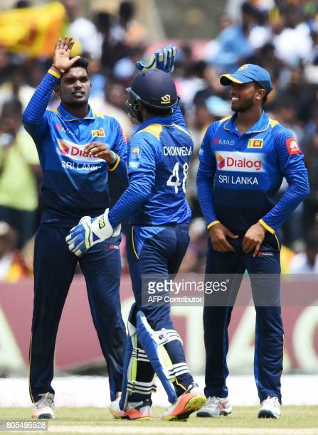 Sri Lanka's Wanidu Hasaranga celebrates with his teammates after he dismissed Zimbabwe's Malcolm Waller during the second oneday international...