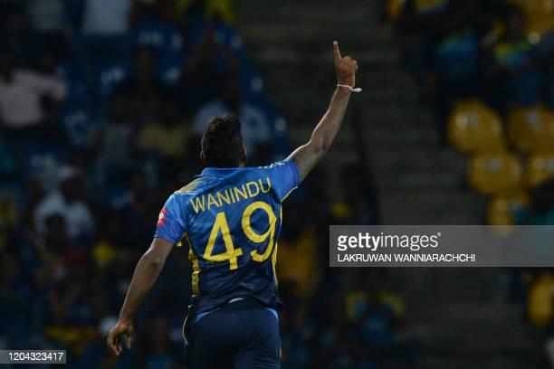 Sri Lanka's Wanindu Hasaranga celebrates after dismissing West Indies Sunil Ambris during the third one day international cricket match between Sri...