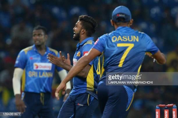Sri Lanka's Wanindu Hasaranga celebrates with his teammates after he dismissed West Indies Darren Bravo during the third one day international...