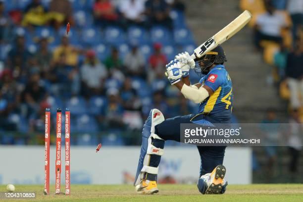 Sri Lanka's Wanindu Hasaranga gets dismissed by West Indies Jason Holder during the third one day international cricket match between Sri Lanka and...
