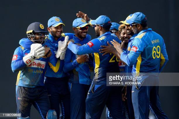 Sri Lanka's wicketkeeper Kusal Perera celebrates with teammates after running out Bangladesh's Sabbir Rahman during the second one day international...