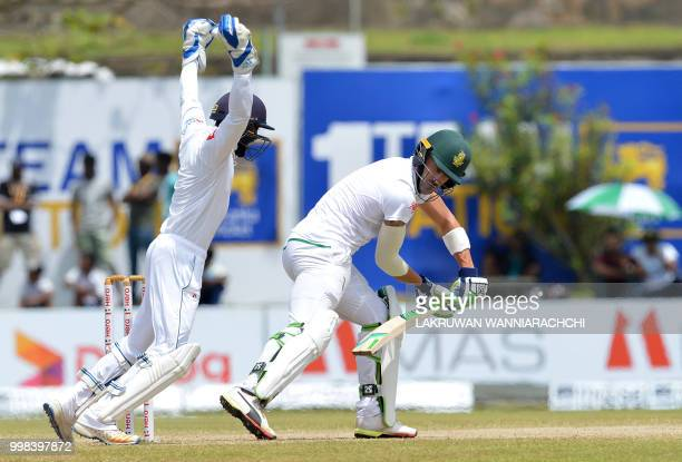 Sri Lanka's wicketkeeper Niroshan Dickwella celebrates after dismissing South Africa's captain Faf du Plessis during the third day of the opening...