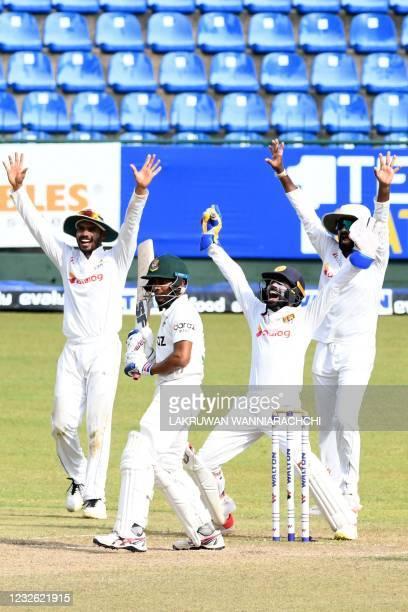 Sri Lanka's wicketkeeper Niroshan Dickwella his teammate Lahiru Thirimanne and Dhananjaya de Silva successfully appeal against the wicket of...