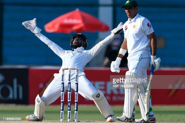 Sri Lanka's wicketkeeper Niroshan Dickwella makes an unsuccessful out appeal against Pakistan's Abid Ali during the third day of the second Test...
