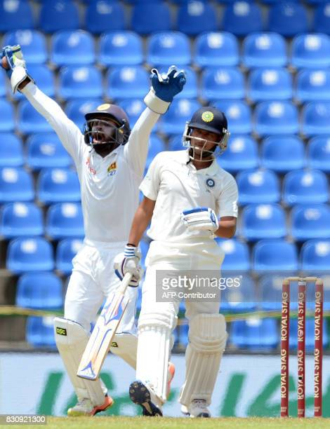Sri Lanka's wicketkeeper Niroshan Dickwella successfully appeals against India's Kuldeep Yadav during the second day of the third and final Test...
