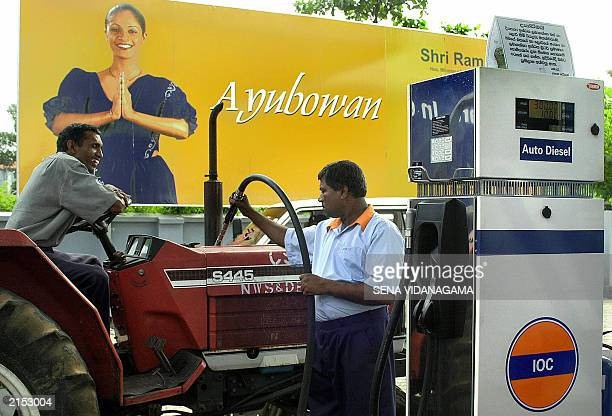 A Sri Lanlan man gets some gasoline at the first Indian Oil Company retail store in Colombo 09 July 2003 The IOC is currently taking over a total of...