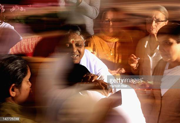 Sri Mata Amritanandamayi Dev known as 'Amma' hugs a visitor on the first day of her Melbourne retreat on April 12 2012 in Melbourne Australia The...