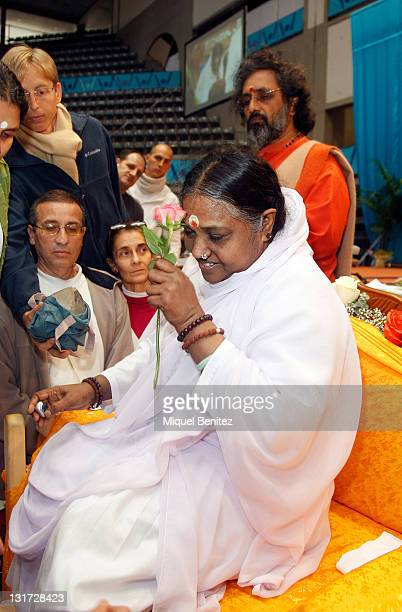 Sri Mata Amritanandamayi Devi known as 'Amma' by her followers performs the Darshan during her visit to Granollers on November 7 2011 in Catalonia...