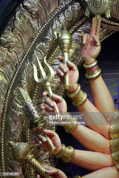 sri veeramakaliamman hindu temple.  hindu deity : sri lakshmi durgai. with 3 omnipotent eyes and 18 hands, she protects and bestows peace prosperity and happiness. singapore. - goddess lakshmi stock photos and pictures