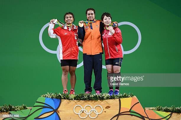 Sri Wahyuni Agustiani of Indonesia , Sopita Tanasan of Thailand , and Hiromi Miyake of Japan pose on the podium after competing in the Women's 48kg...