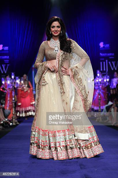 Sridevi Kapoor walks the runway at the Vijay Golecha show during day three of the India International Jewellery Week 2014 at Grand Hyatt on July 16...