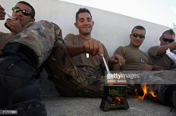 Italian soldiers eat canned food at a military base near the southern Lebanese village of Srifa 03 September 2006 More Italian troops were deployed...