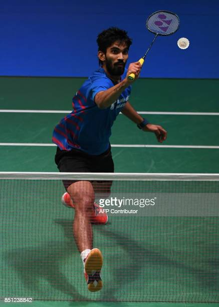 Srikanth Kidambi of India hits a return against Viktor Axelsen of Denmark during their men's singles quarterfinal match at the Japan Open Badminton...