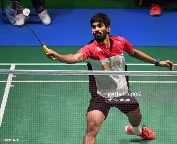 Srikanth Kidambi of India hits a return to Tian Houwei of China during their women's singles first round match at Japan Open Badminton Championship...