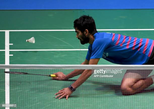 Srikanth Kidambi of India reacts after a point against Viktor Axelsen of Denmark during their men's singles quarterfinal match at the Japan Open...