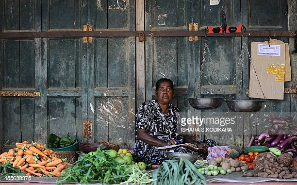 SriLankaconflictwomenrightsFEATURE by Charlotte TURNER In this photograph taken on November 18 a Sri Lankan Tamil vendor waits for customers at a...