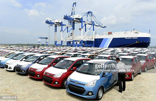 SriLankaeconomyinfrastructureFOCUS by Amal Jayasinghe In this photograph taken on February 10 a Sri Lankan official looks at cars standing at the...