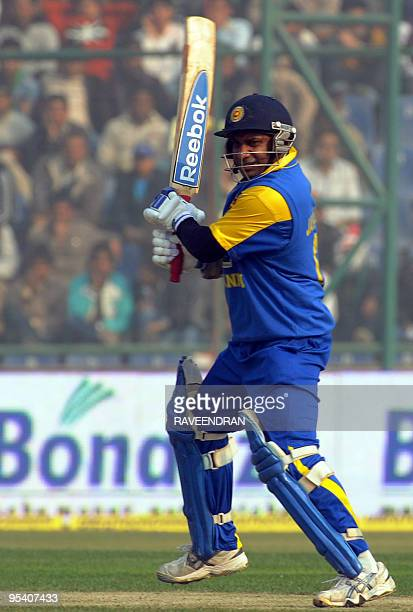 Srilankan batsman Sanath Jayasuriya watches the ball after playing a stroke during the fifth and final One Day International cricket match between...