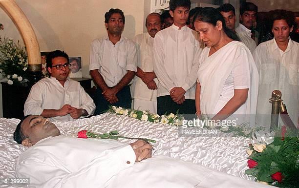 Srima Diaananyake widow of Sri Lanka's assassinated opposition leader Gamini Dissanayak looks down over her slain husband's body at the family...