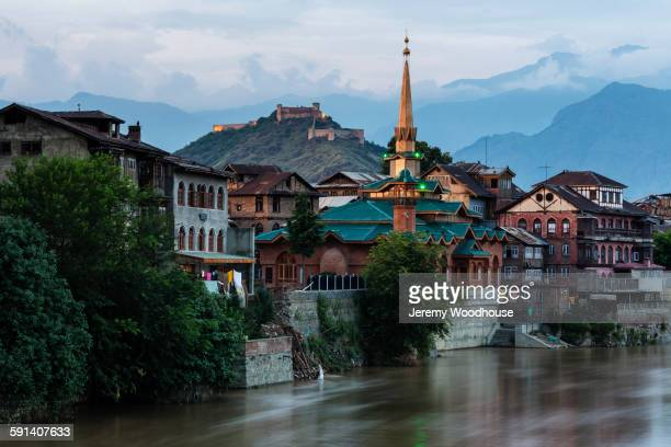 srinagar buildings over river, kashmir, india - srinagar stock pictures, royalty-free photos & images
