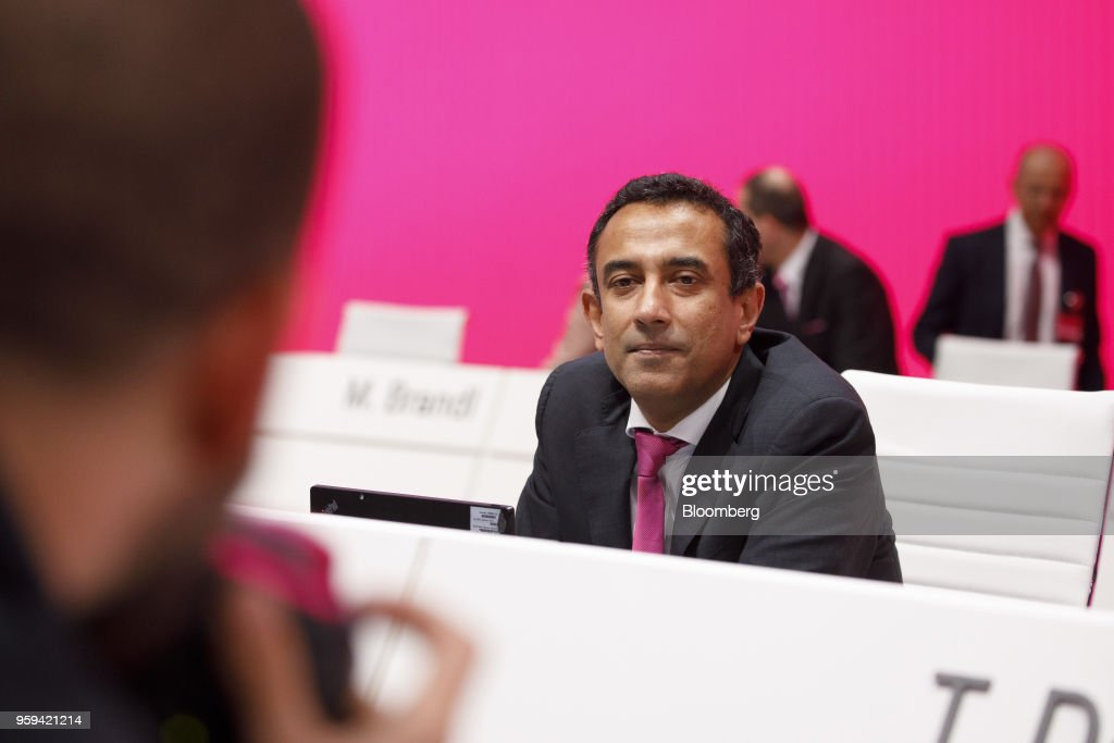 Srini Gopalan, board member of Deutsche Telekom AG, looks on during the company's shareholders' meeting in Bonn, Germany, on Thursday, May 17, 2018. Deutsche Telekom and Daimler AG agreed to settle a 14-year-old arbitration case with the German government over the countrys truck toll system with a cash payment of 1.1 billion euros, the Transport Ministry said in a statement. Photographer: Alex Kraus/Bloomberg via Getty Images