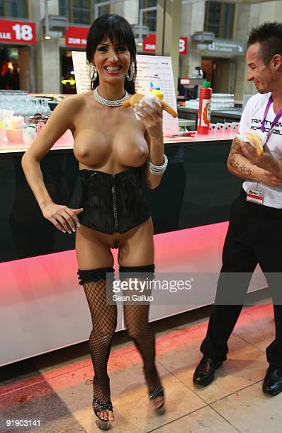 A srtipper and a colleague buy lunch at the Venus erotic trade fair during the press and industry professionals' day on October 15 2009 in Berlin...