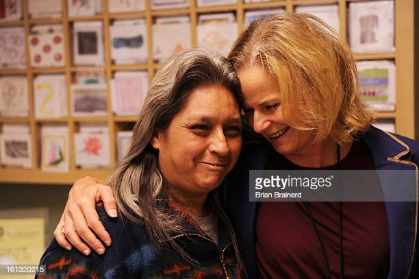 ss14gathering_bb_2 Mary Drazkowski a long time client of The Gathering Place is embraced by CEO Leslie Foster at the daytime facility for homeless...