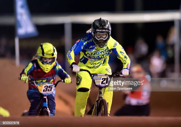 Ssquared Bicycles' Lauren Reynolds of Australia leads Supercross BMXs Rachel Mydock through the third straight during Elite Women's action at the USA...