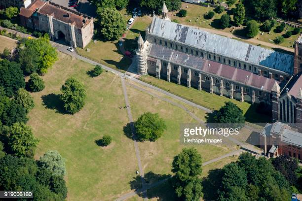 St Albans Abbey, Hertifordshire, 2015. The nave and gatehouse of the abbey. Parchmarks in the grass show the outline of the cloister and cellar of...