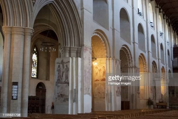 St Alban's Cathedral, St Alban's, Hertfordshire, England, UK, 4/6/10. Norman arches and medieval wall paintings of St Alban's Cathedral. The...