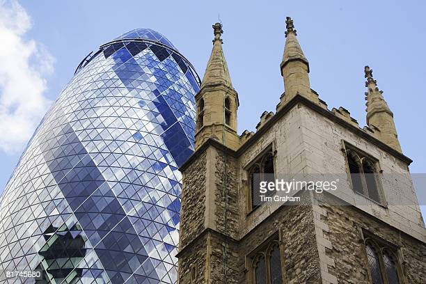 St Andrew Undershaft Church in front of the Swiss Re Building London England United Kingdom