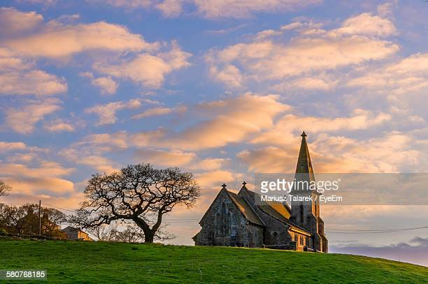 st andrews church by bare trees against sky at sunset - ハロゲート ストックフォトと画像