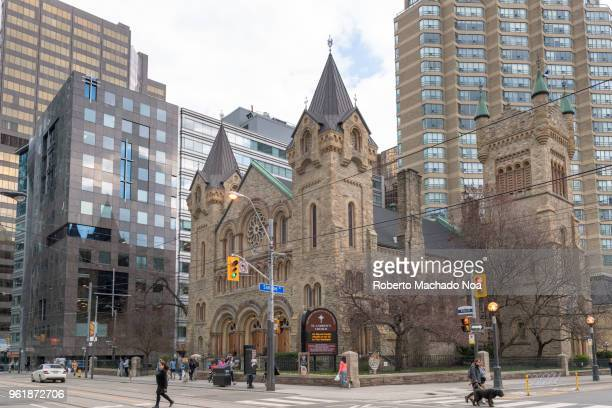 st. andrew's church in a downtown district corner, toronto, canada - presbyterianism stock photos and pictures