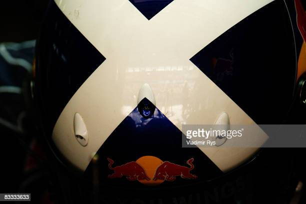 St Andrews Cross is seen on the helmet of David Coulthard of Great Britain and Red Bull Racing during qualifying for the Chinese Formula One Grand...