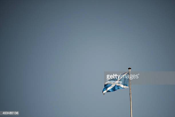 A St Andrew's or Saltire flag the national flag of Scotland flies from a flagpole in Edinburgh UK on Saturday Aug 9 2014 Scottish First Minister Alex...