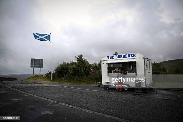 A St Andrew's or Saltire flag the national flag of Scotland flies near a mobile food truck near the Scottish border with England near Hawick UK on...