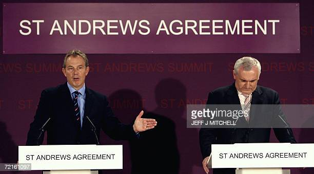 St Andrews, UNITED KINGDOM: British Prime Minister Tony Blair and Irish Prime Minister Bertie Ahern speak during a press conference 13 October 2006...