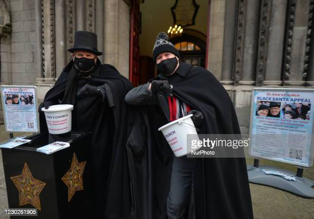 St Ann's vicar, Canon David Gillespie and and caretaker Fred Deane stand outside the church during the annual seven-day Black Santa charity sit out...