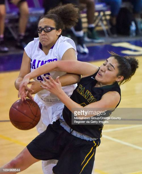 St Anthony's Lauryn Morris left and Canyon's Alaina Garcia fight over a rebound in Long Beach CA on Saturday February 25 2017 St Anthony...