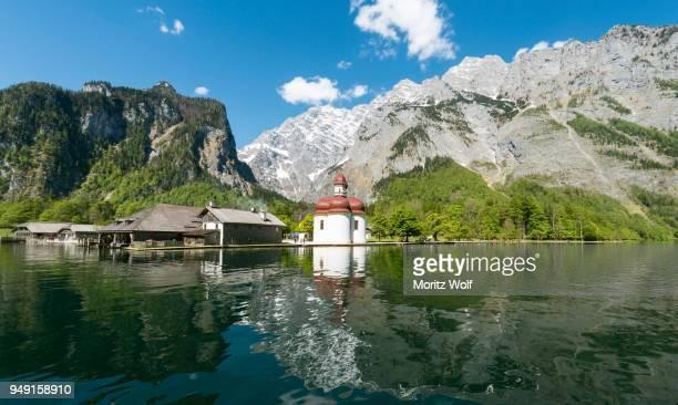 st. bartholomews church, reflection in water, koenigssee, lake, watzmann mountain, berchtesgaden national park, berchtesgadener land, upper bavaria, bavaria, germany - berchtesgaden national park stock photos and pictures