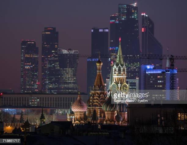 St Basils Cathedral And Spasskaya Tower In Illuminated City Against Sky At Night