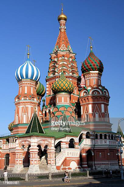 CONTENT] St Basil's Cathedral in Red Square Moscow Russia with couple walking by