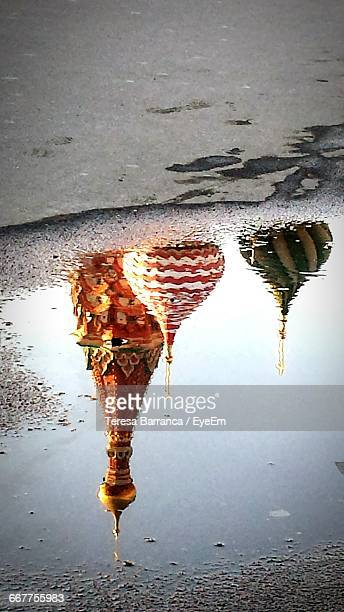 St Basils Cathedral Reflecting In Puddle On Street